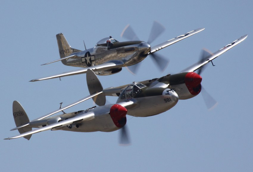heres the other p 38 in formation with a p 51 in its original aluminum finish