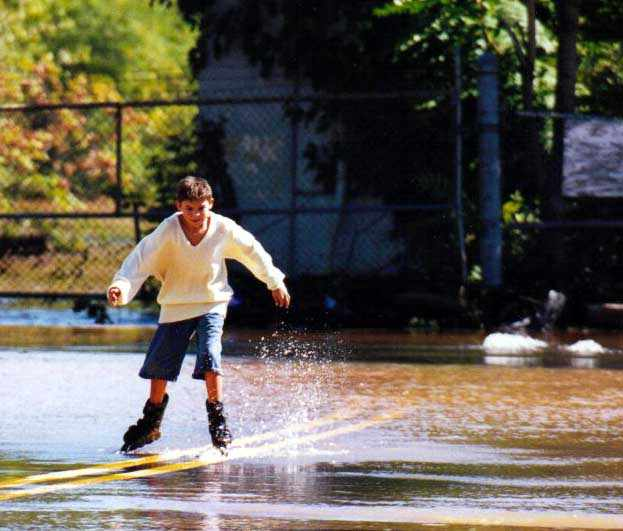 Kid rollerblading down the