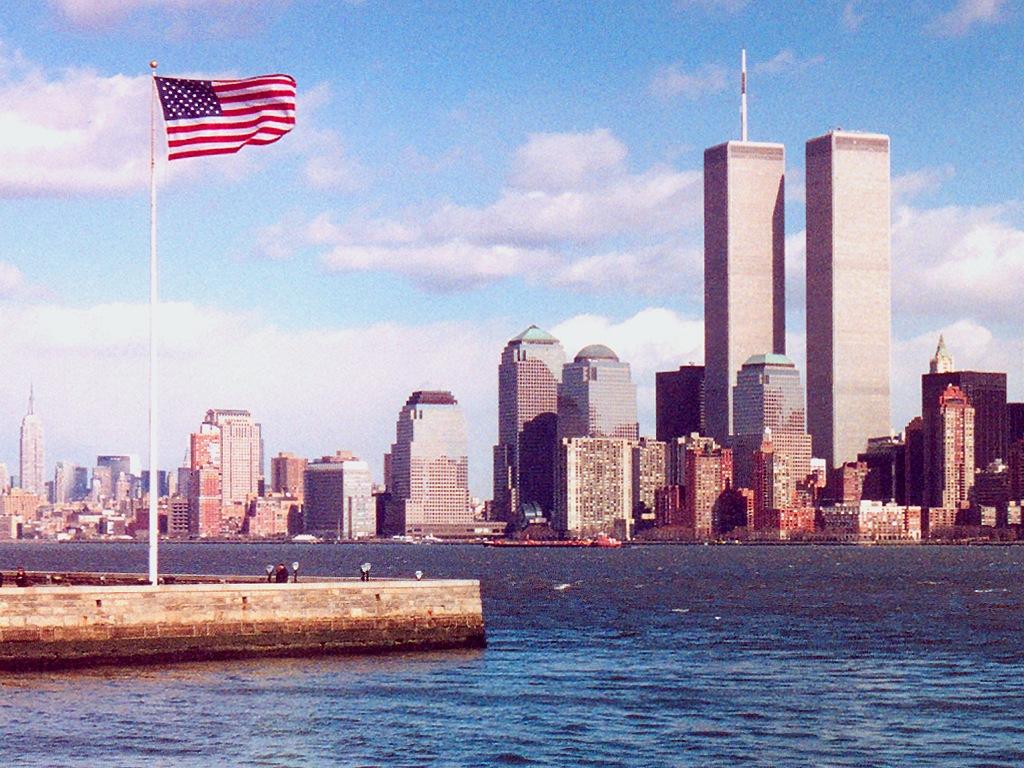 http://www.richard-seaman.com/Wallpaper/USA/Cities/NewYork/LowerManhattanAndAmericanFlag.jpg
